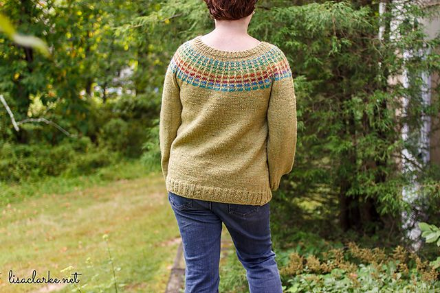 The Porthole Pullover's colorful yoke is inspired by that of the Porthole Cardigan baby sweater and is deceptively simple to achieve. Through the use of self-striping yarn and strategically-placed slip stitches, even a beginner can knit this look.