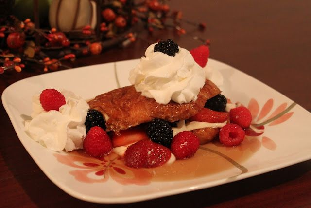 Croissant French Toast with a Sweet Cream Cheese and Creme Fraiche filling, whipped cream, berries and maple syrup--I think I'm seeing a pattern here.
