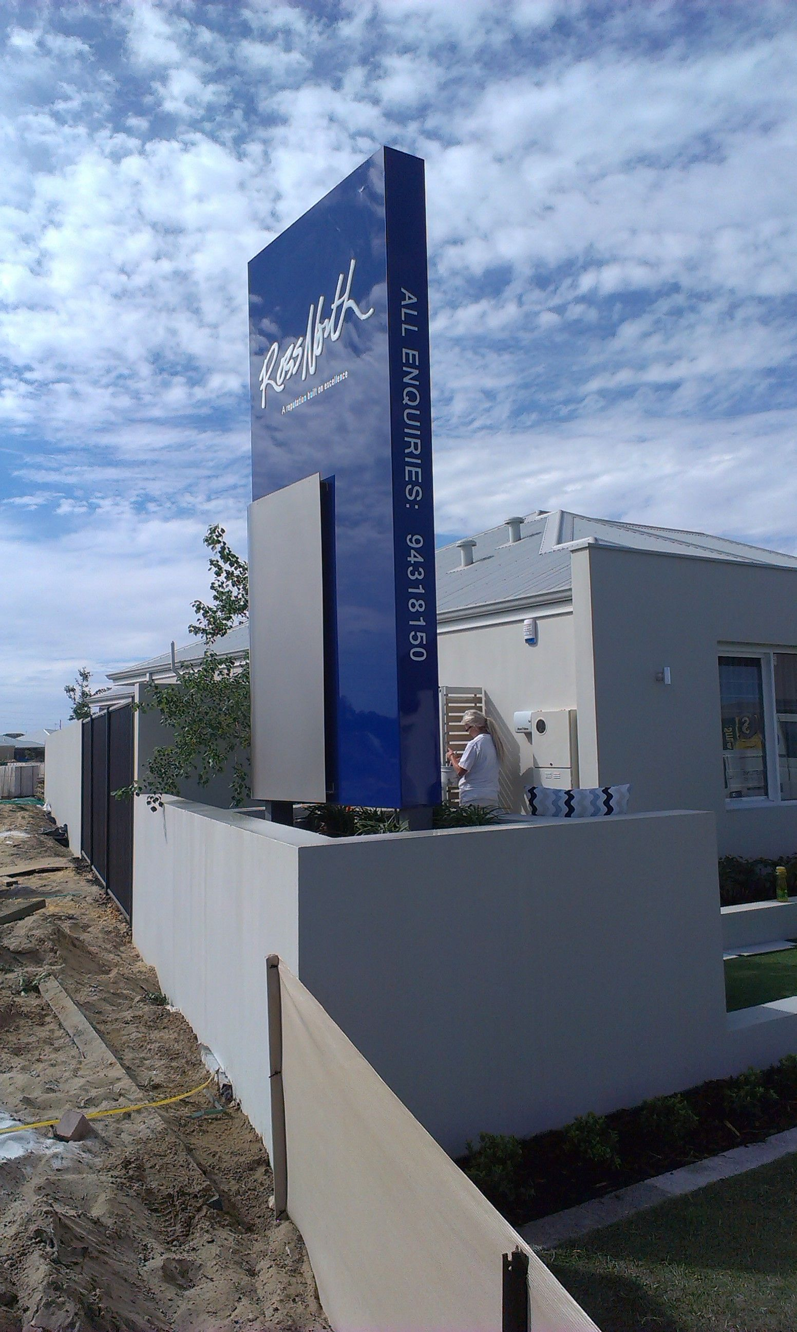 Ross north homes monolith pylon sign with rolled stainless for Ross north home designs