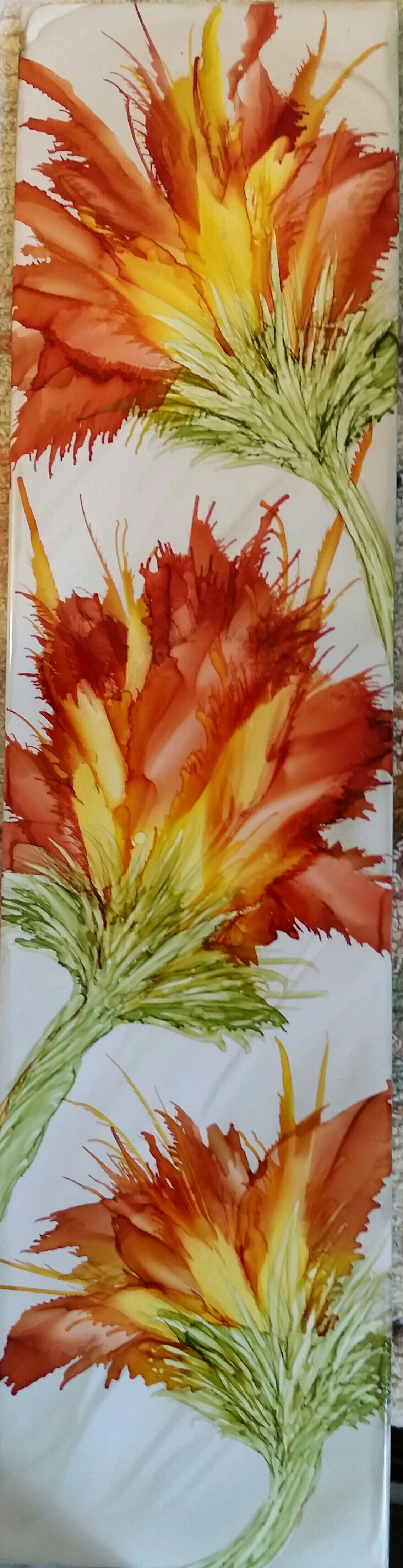 Flower in my favorite alcohol ink colors on long 16x4 ceramic tile by Tina