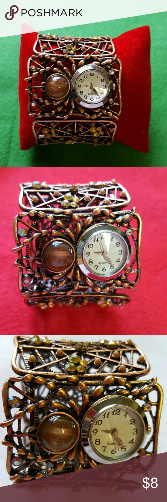 Bangle with Watch Bangle with watch in great condition ,watch is working in copper color, the bangle is adjustable,the width of the bangle is 2 inches. Quartz Accessories Watches