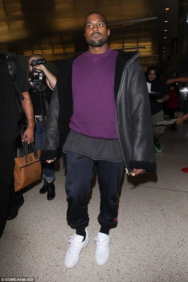 Kanye West wearing Yeezy Season 3 Hooded Shearling Jacket in True Onyx and Adidas  Yeezy Season