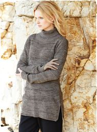 Our silky, pima tweed pullover is a delight for layering or on its own. Knit in a lofty, textural tuck stitch, the easy, straight-falling style is detailed with a ribbed turtleneck, drop shoulders, ribbed cuffs and side slits.