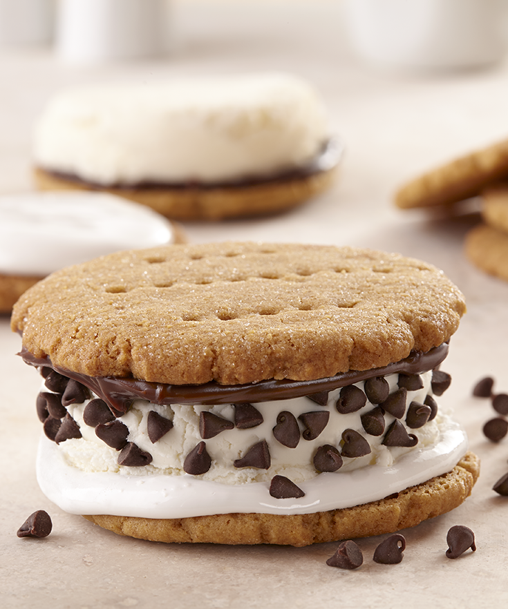 The best ice cream sandwiches are made with soft graham cracker cookies, vanilla ice cream, marshmallow fluff, hot fudge and chocolate chips.