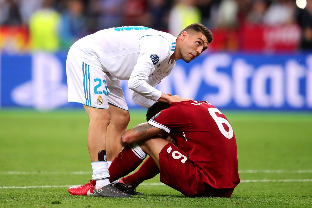Dejan Lovren Of Liverpool Is Consoled By Mateo Kovacevic