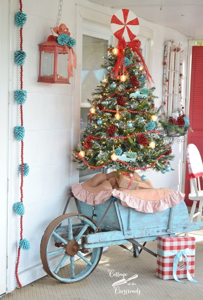 not my real style but love this done well retro red and aqua christmas porch cottage at the crossroads