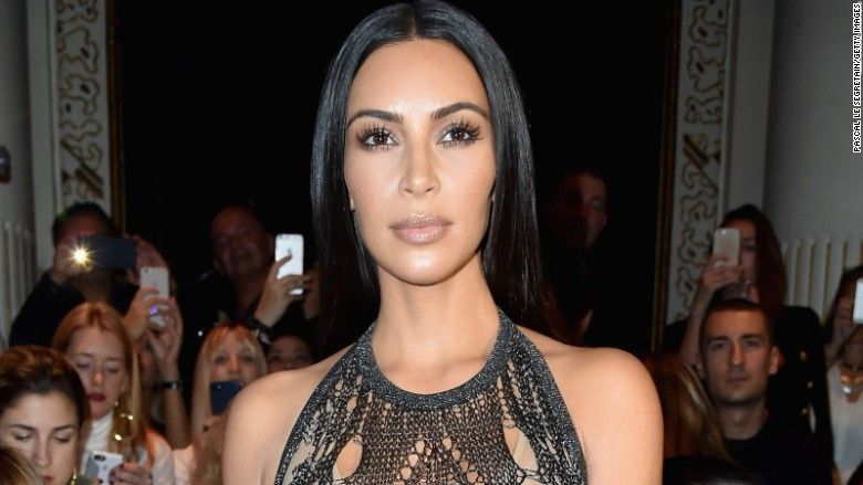 Kim Kardashian West has dropped a lawsuit against gossip site MediaTakeOut after it admitted that its reports suggesting she staged a Paris robbery were false.