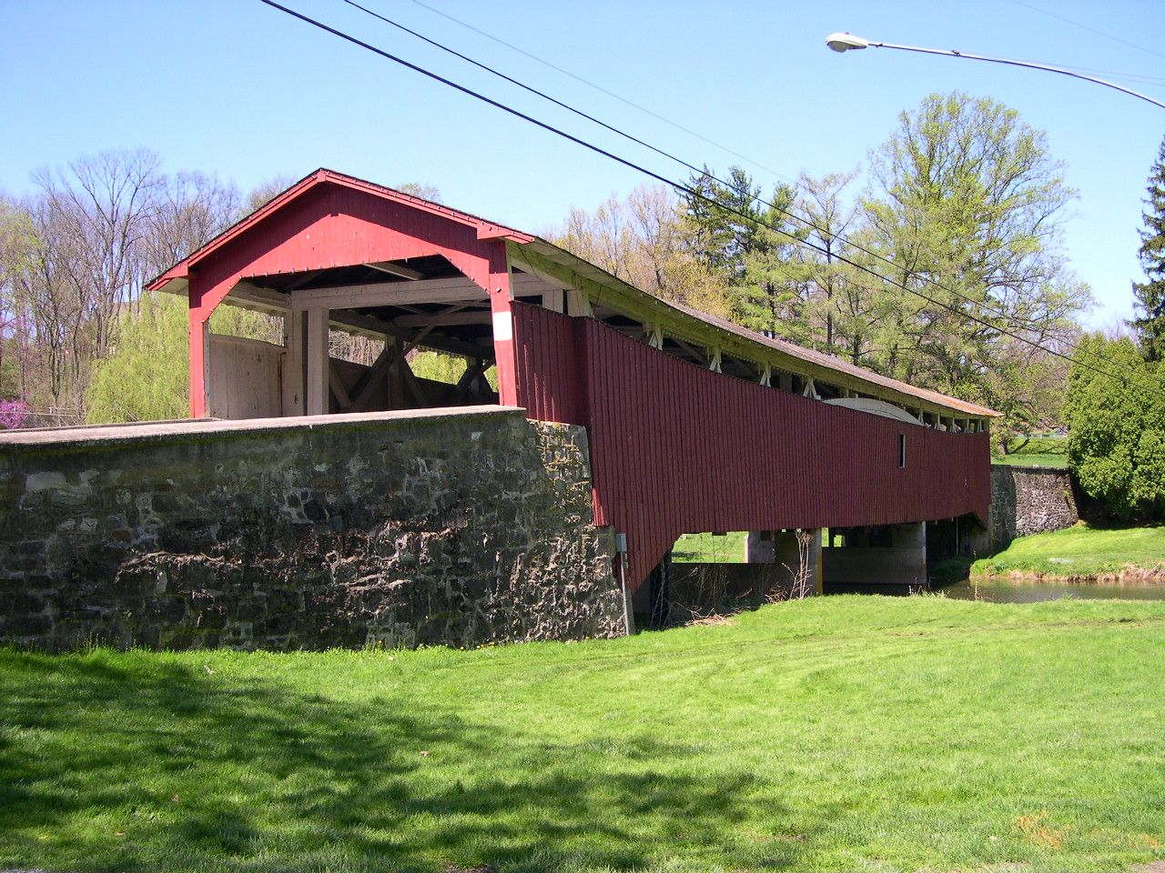 Bogert Covered Bridge, Allentown, PA.  On Natl. Register of Historic Places. 145-foot-long, constructed in 1841. It has vertical plank siding and a gable roof.