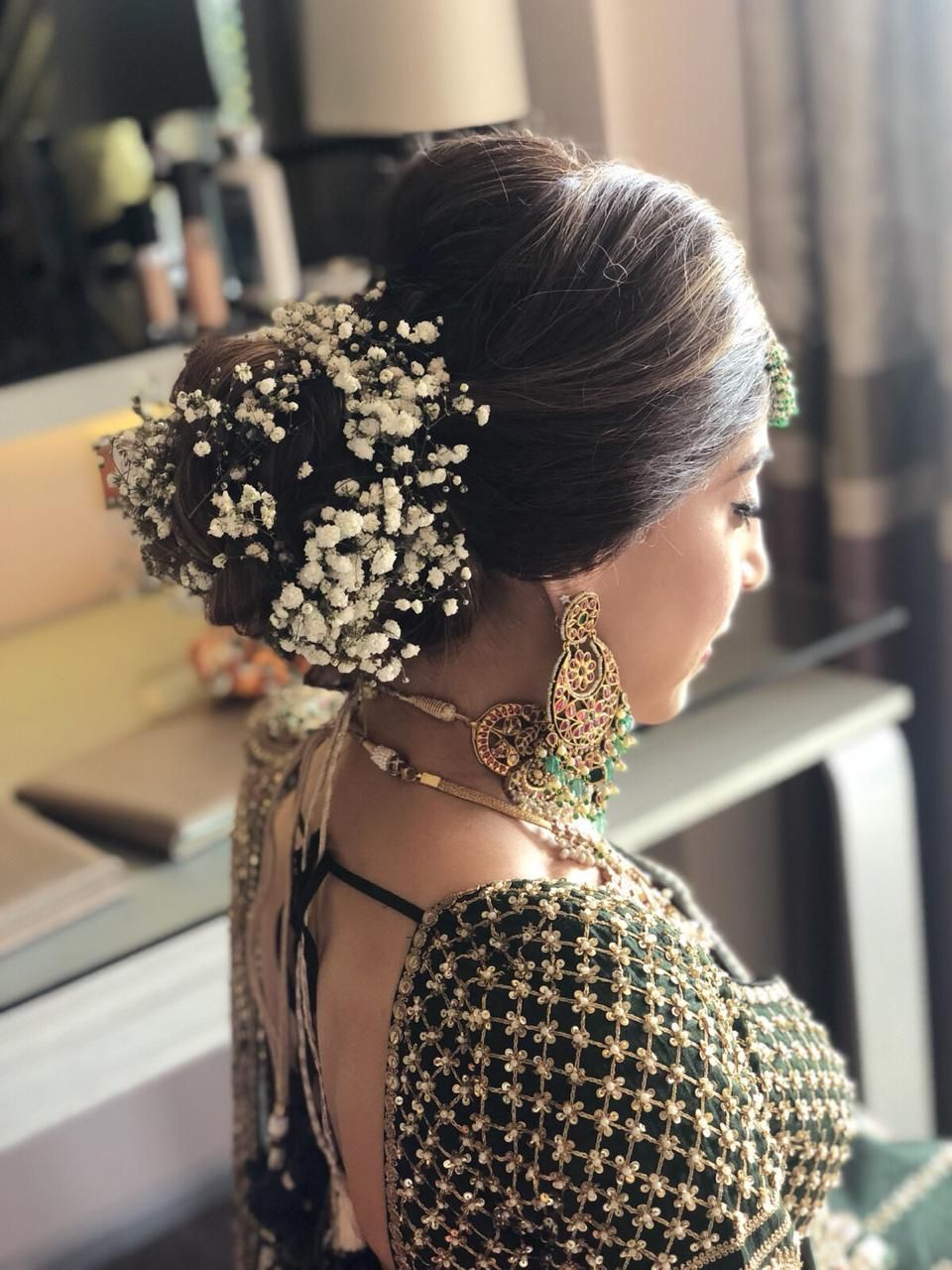Pretty Bridal Bun With Baby Breath Flowers For An Indian Wedding See More On Wedmegood Com Wedme Bridal Hair Buns Indian Hairstyles Indian Bridal Hairstyles
