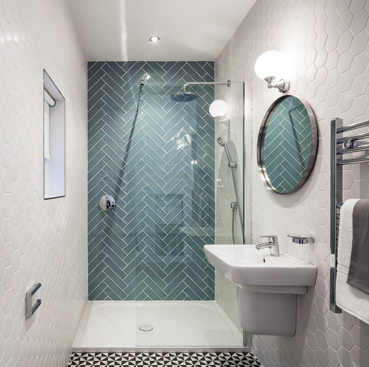 Small quirky bathroom design with seamless double shower, hexagonal ...