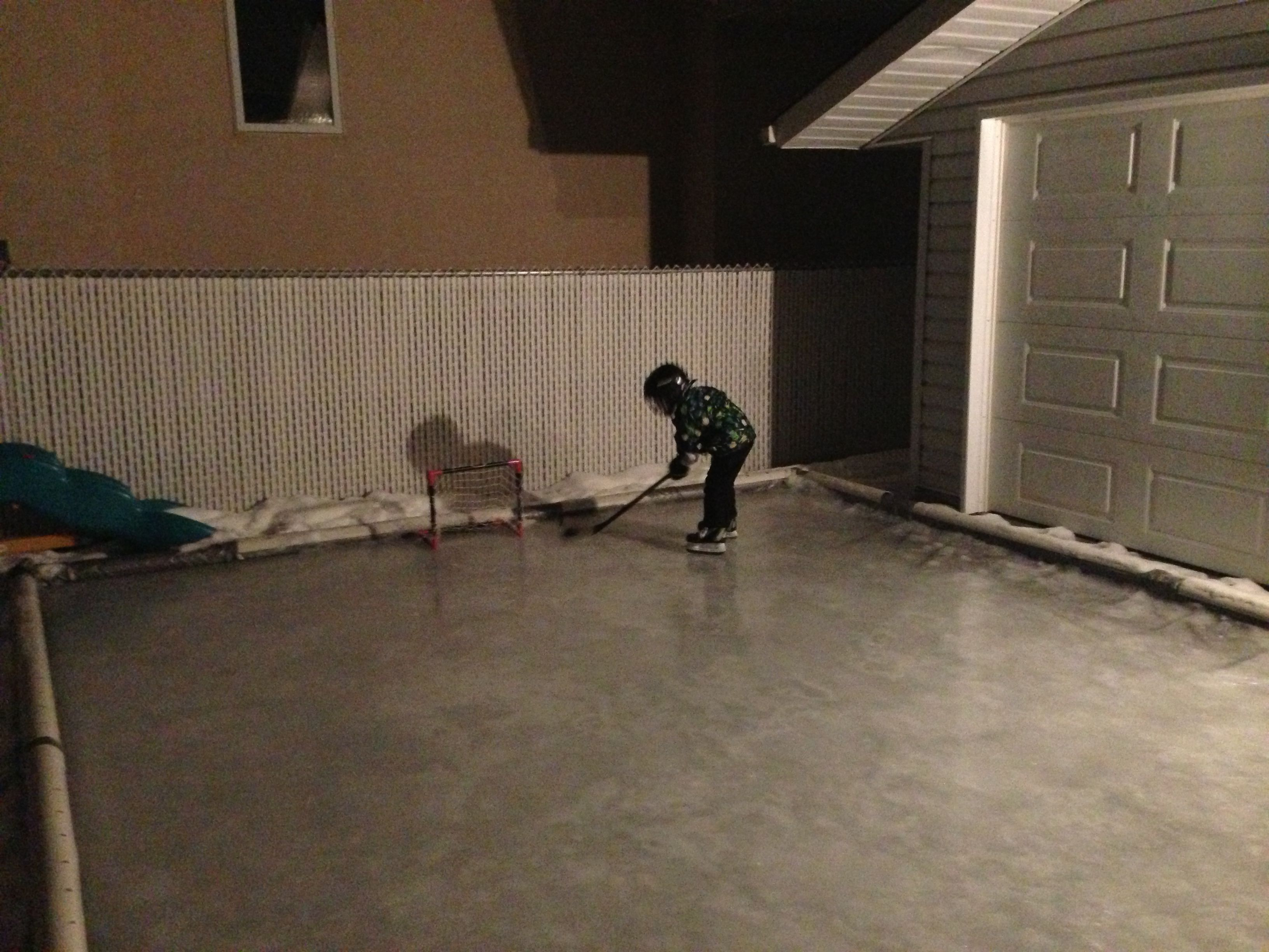 make an ice rink in your backyard plastic tarp laid down with