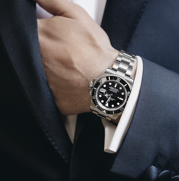 A Rolex Submariner Date and a fine dinner jacket. Two ...