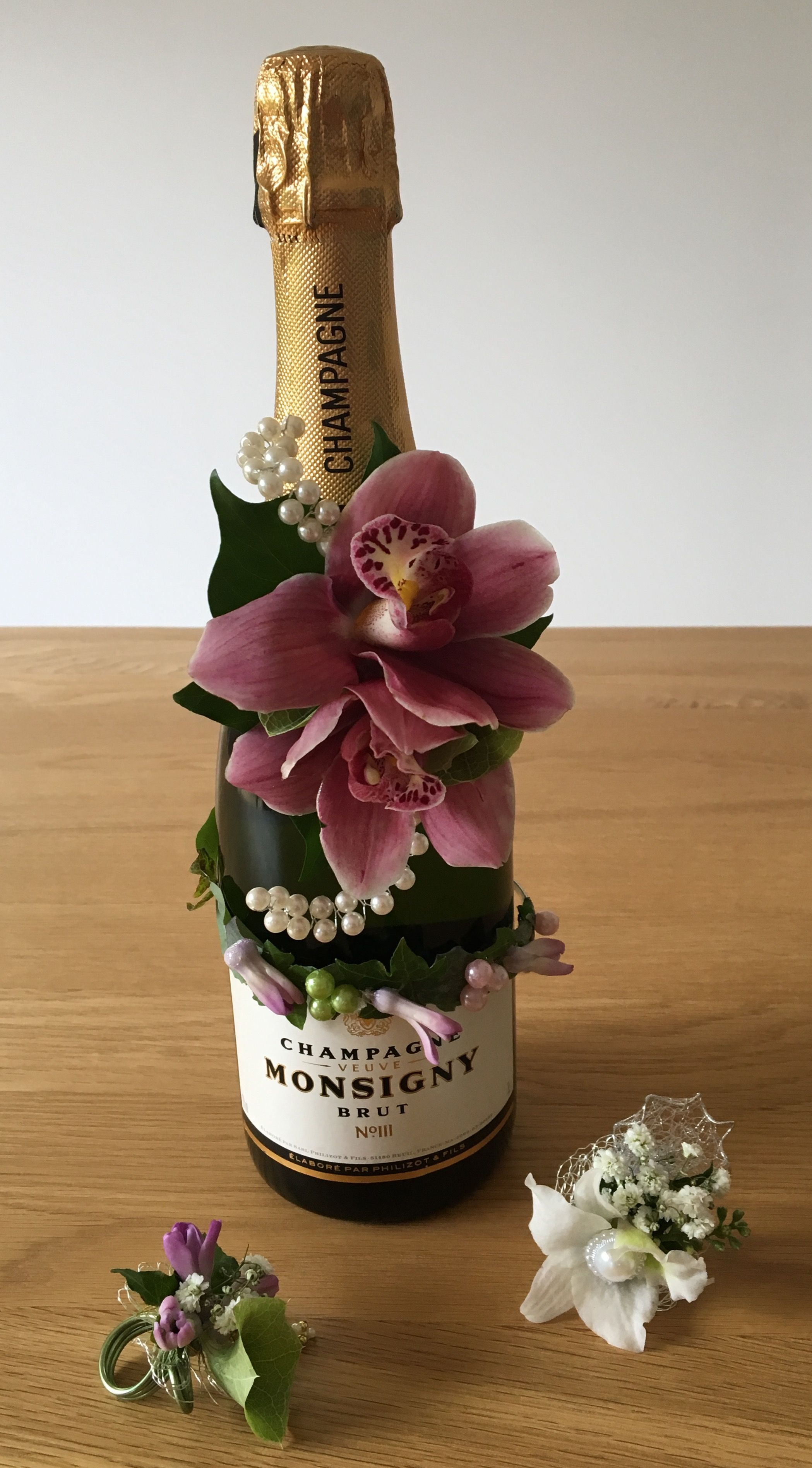 Wedding Flowers Corsage Rings And Decorated Champagne Bottle With Pearls Orchids Ivy Hyacinth