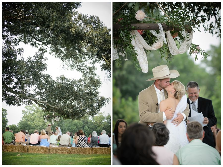 greenville sc wedding photographer photographers, rustic wedding ideas, outdoor wedding ideas, farm weddings, unique ceremony, bride and groom married under trees, wagon wheel flower arrangement hanging from tree, hay bale seats, groom wearing cowboy hat