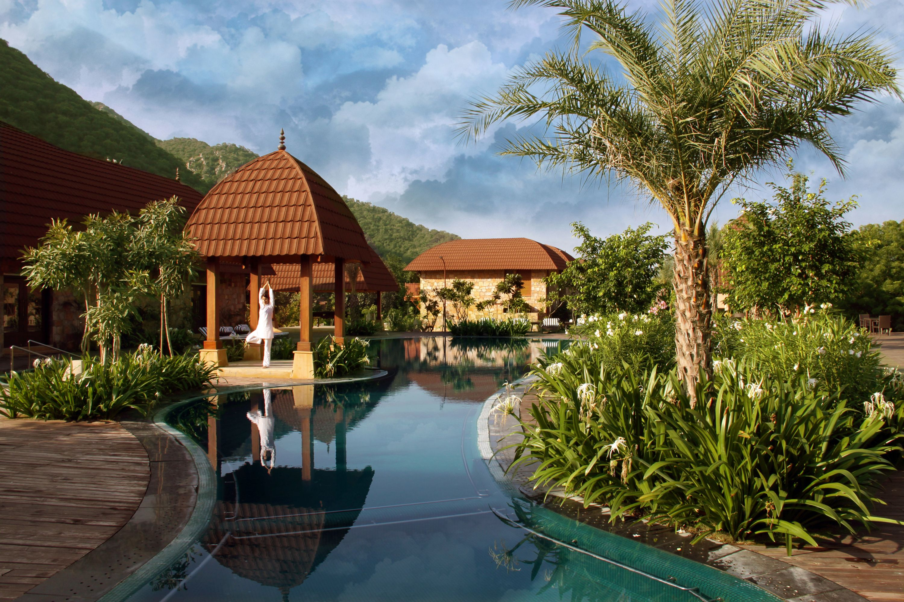 Awaken the morning with a #harmonious #yoga and in #luxurious brown tiled #ambiance beside the blue #calm water.