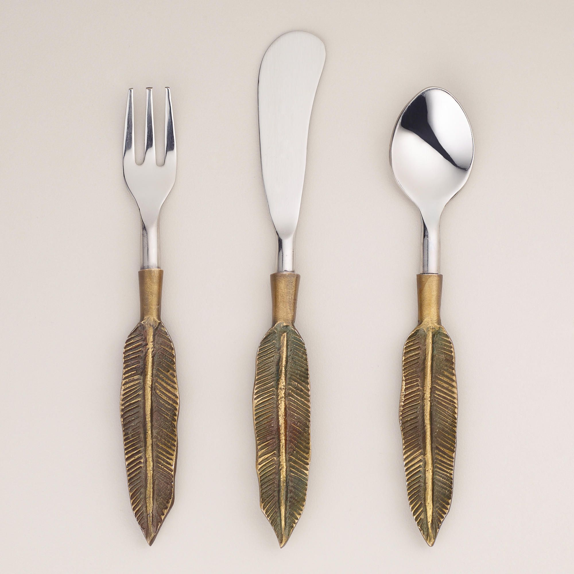 Feather cocktail flatware collection world market kitchen accesories pinterest flatware - Almoco flatware ...