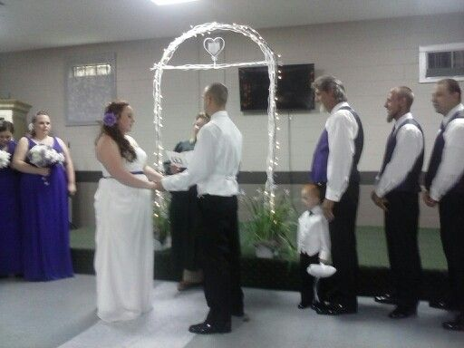 Congradulations T.J.n Jerri,they put lights on the arch.i put purple Irises in rail pots.arch is tent poles n wire.sucsess,yay