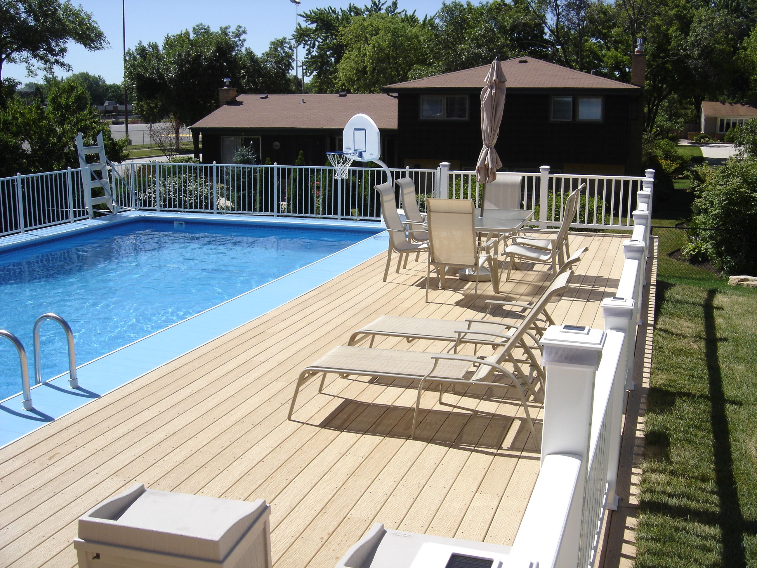 Small yard above ground pool designs above ground for Above ground pool with decks
