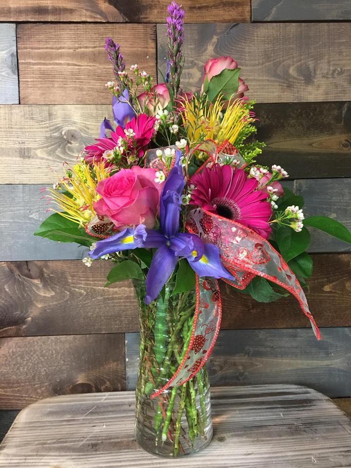 Bright fun colorful floral arrangement pinkroses