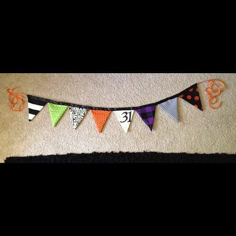 The Halloween banner I made. It's made out of fabric pennants and silk ribbon, sewed together. I used a Cricut to cut out the number 31 on thick bristol, then stenciled it onto the muslin pennant and filled it in with black fabric paint. Ta-da!