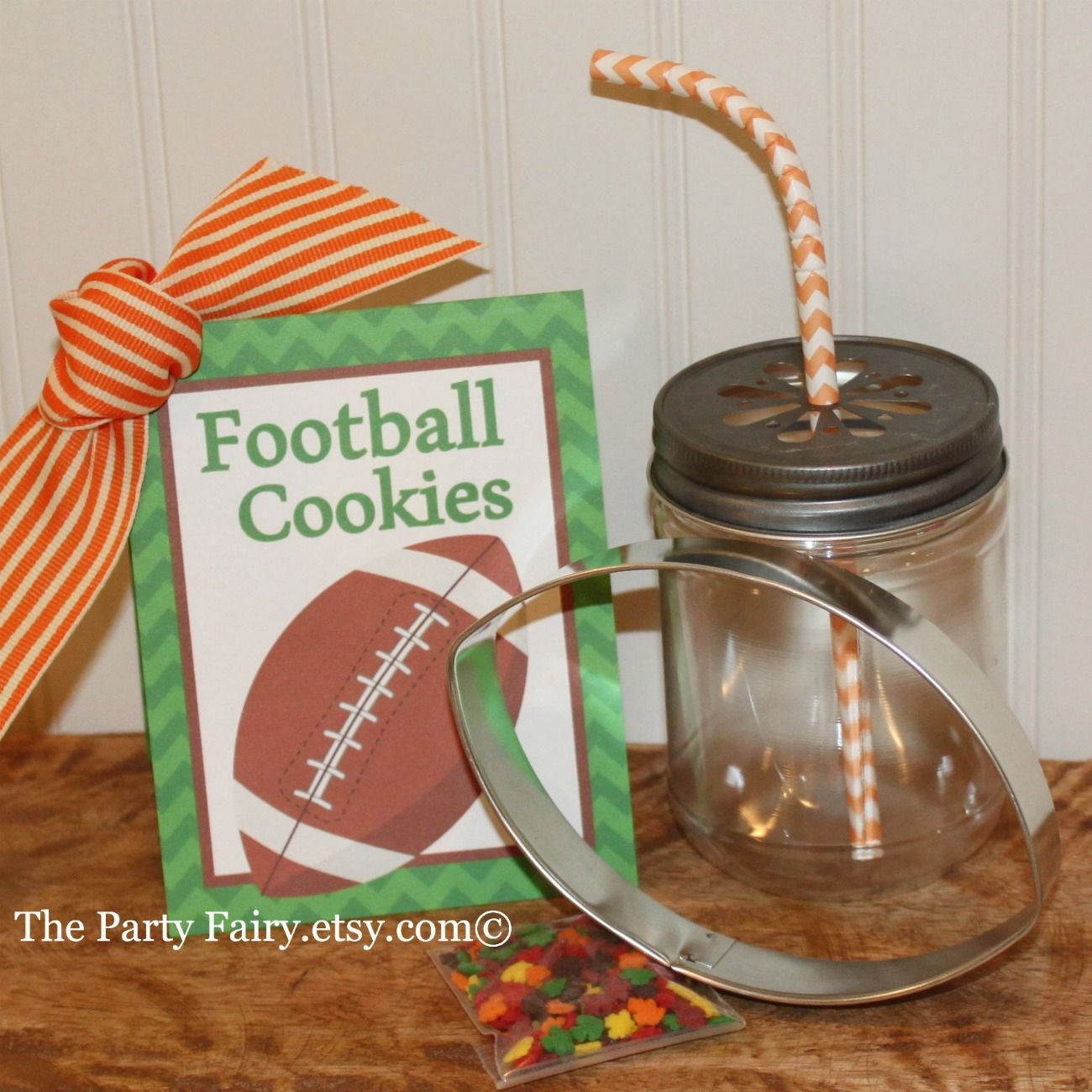 Football cookie cutter with recipe card and sprinkles