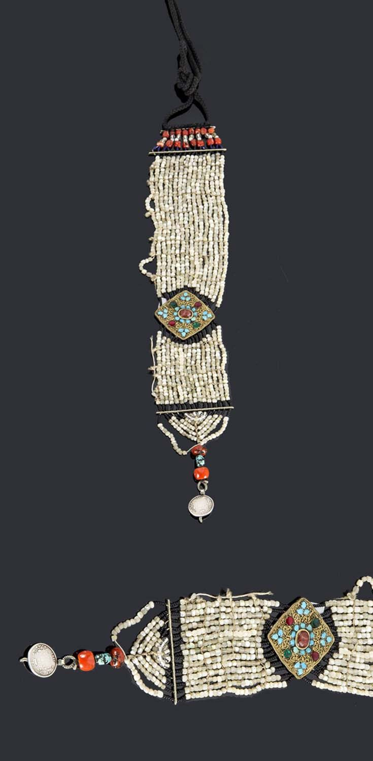 Himalayas | Dress ornament; pearls, coral, gilded bronze plate decorated with turquoise and glass cabochons. L: 35 cm | Sold ~ (June '15)