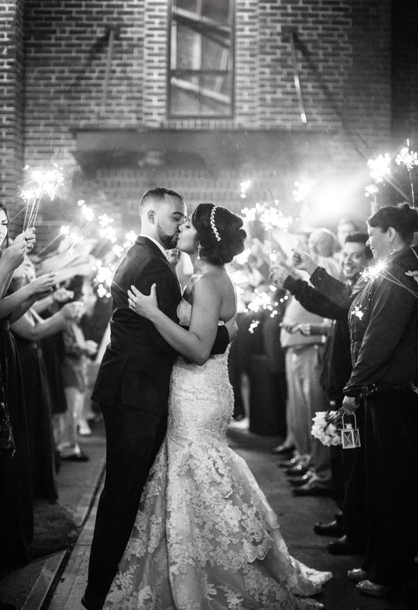 Kiss in a sea of sparklers Hannah Woodard Photography Wedding