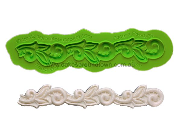 Dimensions: 6.25 L x 1 W Kelly is a Silicone Lace Border Mold that uses elegant scrolls and leafy  foliage to creat
