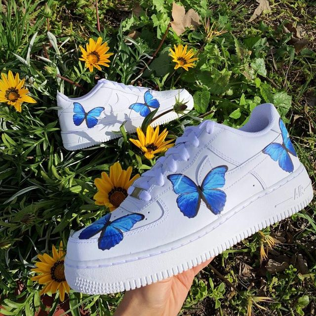 This Sneaker is a high quality Air Force 1 customized with blue butterflies scattered on the side of the shoe. This item looks great on foot and has a nice aesthetic. It is hand-customized by me and is great quality. This order will ship within 3-4 weeks or even earlier!