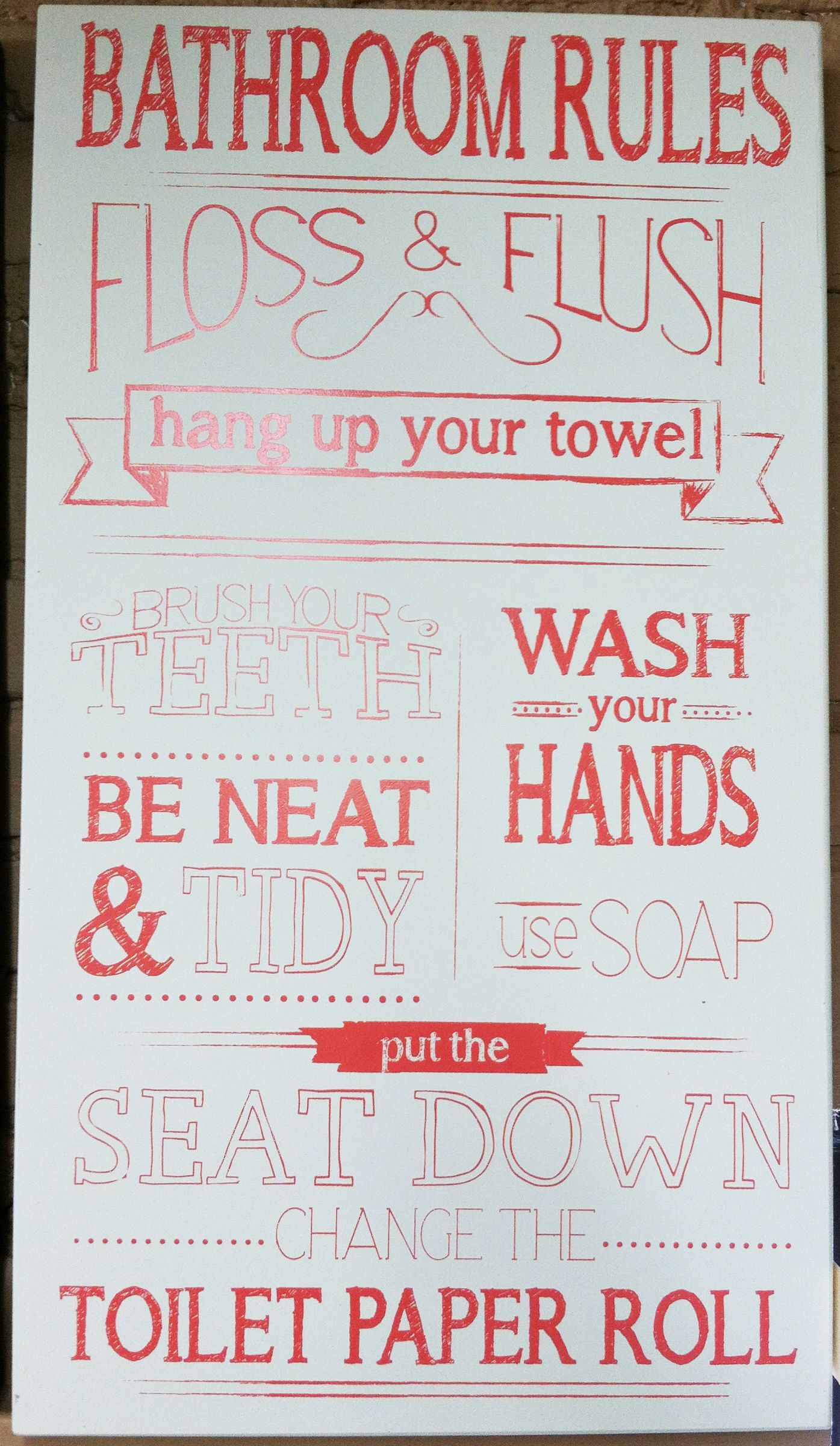 Bathroom Rules: Floss & Flush, hang up your towel, brush your teeth, be neat & tidy, wash your hands, use soap, put the seat down, change the toilet paper roll. Sign - Find at Discount Furniture Outlet in Richfield, UT