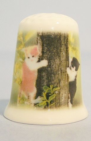 Cats in tree porcelain thimble