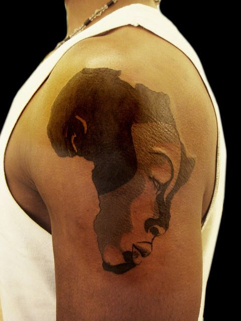 Elephant Africa Continent Tattoo | Half Face On Shoulder