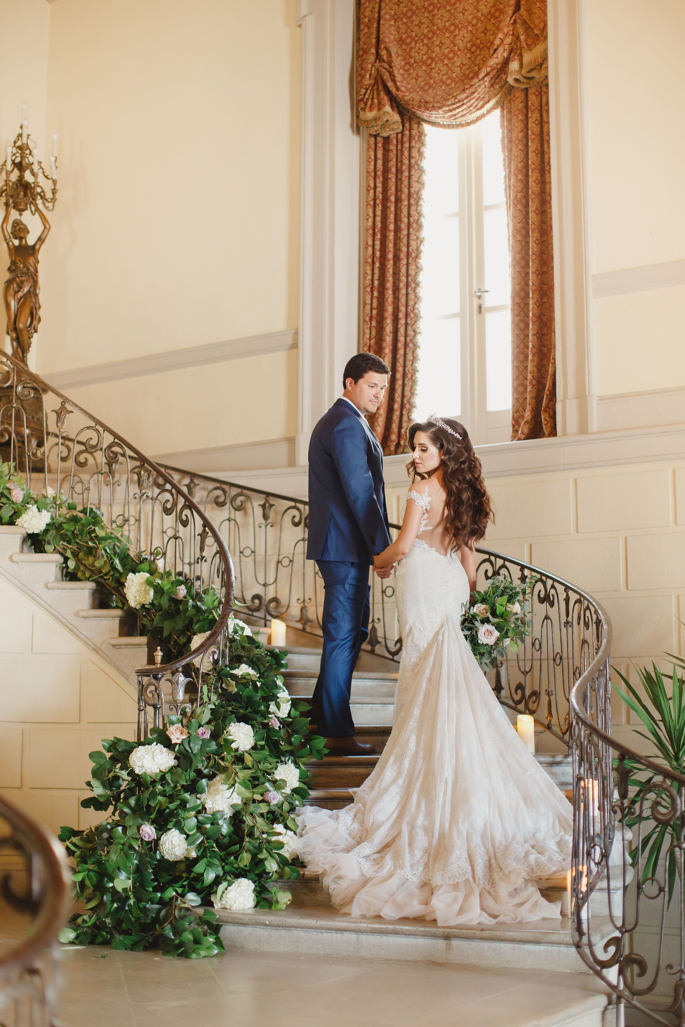 Fairytale Wedding At Oheka Castle In Long Island Ny Bride And Groom Walking Up Staircase Covered In Gre Oheka Castle Wedding Photography Bride Wedding Photos
