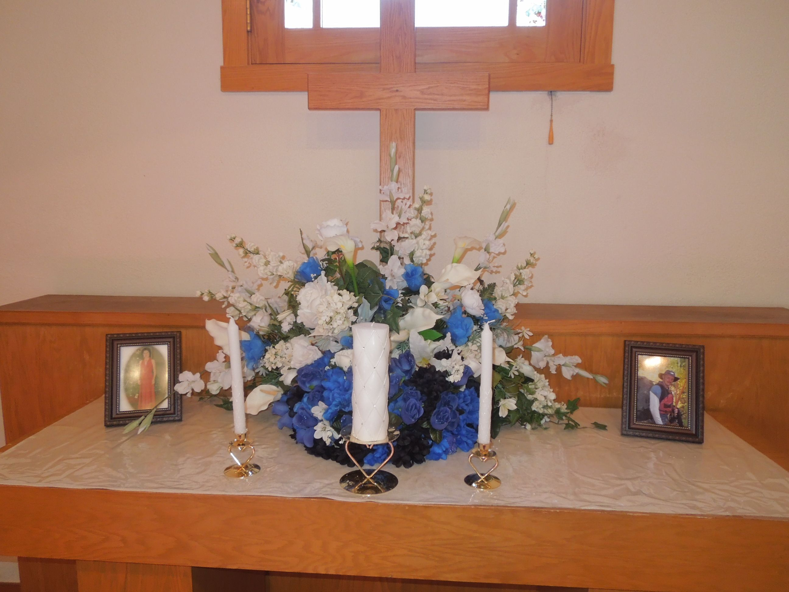 Wedding decorations: The altar at Foothills Wedding Chapel has room for flowers, an optional cross, unity candle, space for license signing, and family memorial pictures. This couple remembered loved ones who are with them in spirit.