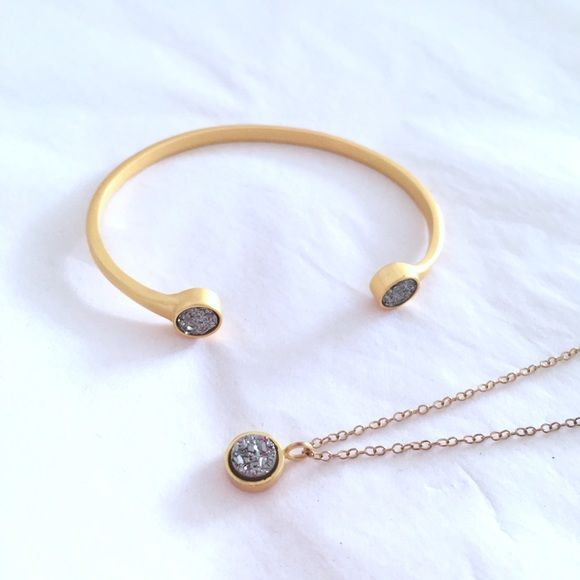 Kristine Lily Druzy Pop Cuff & Necklace Set Gently use only a few times.  •  I'm only selling. Price is firm • All Kristine Lily jewelry is nickel free  Necklace: $49 retail  Dainty cable chain necklace w/ a silver druzy quartz gemstone bezel set in 18k yellow gold vermeil. 14k gold filled & 18k gold vermeil brushed/matte finished 6mm druzy quartz. 16'' handcrafted  Cuff: $85 retail Two druzy gemstones bezel set in a malleable/adjustable cuff.  Gemstone: 6mm round 24k yellow gold plated…