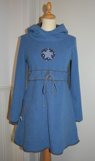 Instructions are in ? German? Dutch?, but it would be easy to make by using the top half of a hoodie pattern and adding a belted middle and a skirt.