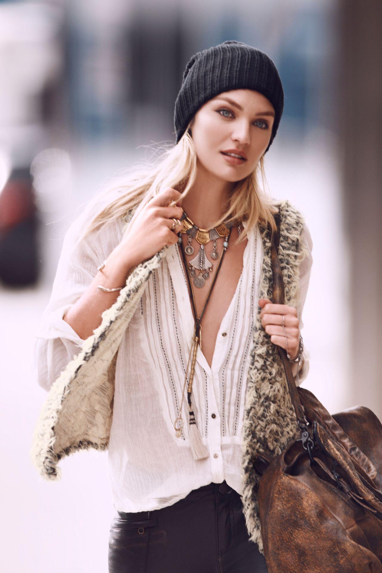 Love her shirt, vest, necklace, & bag! Great Ensemble