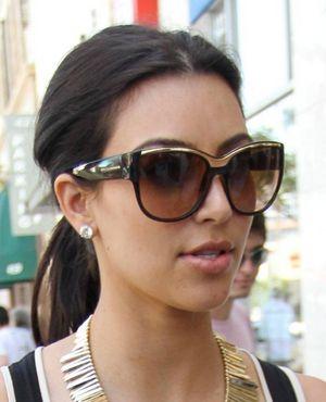 ca5210447ce7 Kim Kardashian wearing Dolce   Gabbana sunglasses. Love the gold trim along  the top of the frame!