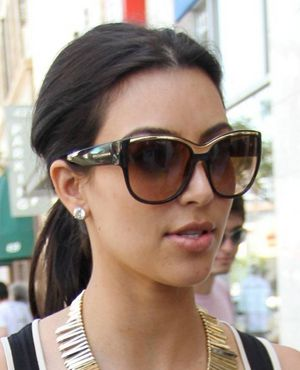 5a04a92ccbe6 Kim Kardashian wearing Dolce   Gabbana sunglasses. Love the gold trim along  the top of the frame!