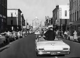 John F. Kennedy campaigns through State Street in downtown Rockford, Illinois in 1960.