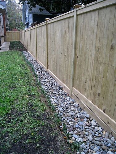fence and stones yard drainage