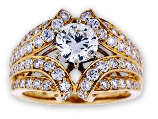 This diamond cluster ring includes a 1.15 carat center diamond
