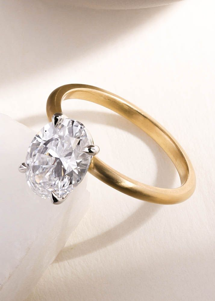 Simple oval diamond engagement ring in yellow gold ...