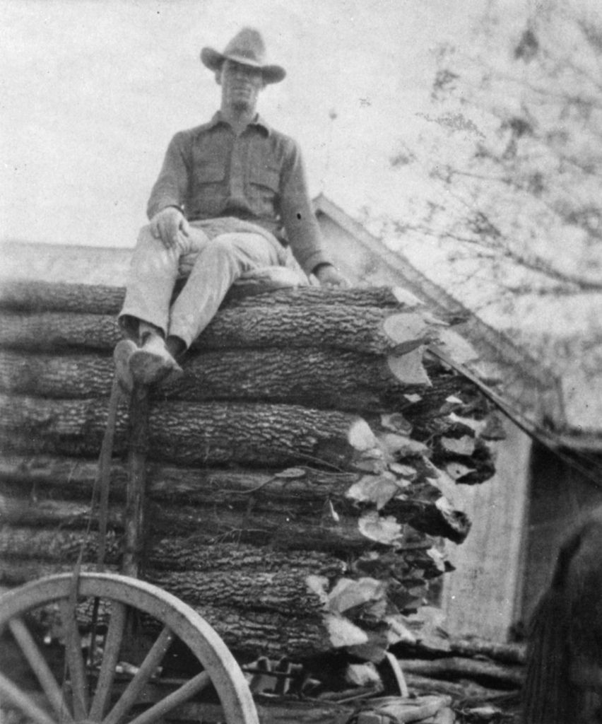 """Mr. Robert Egger with a load of winter fuel. This was the method of getting the winter supply of wood for both heating and cooking. This load came from the Herbert Ganzert Ranch west of Round Rock in the year 1922. (From """"Round Rock, Texas, U.S.A.!!!"""" page 34)"""