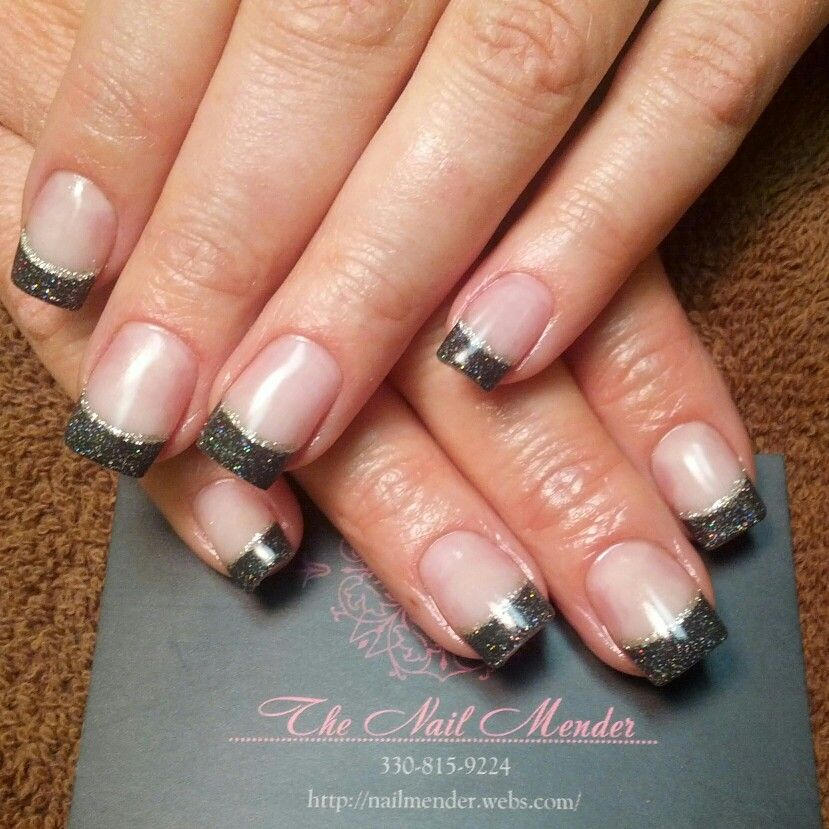 Sparkly black tipped acrylic nails with silver stripe. # ...
