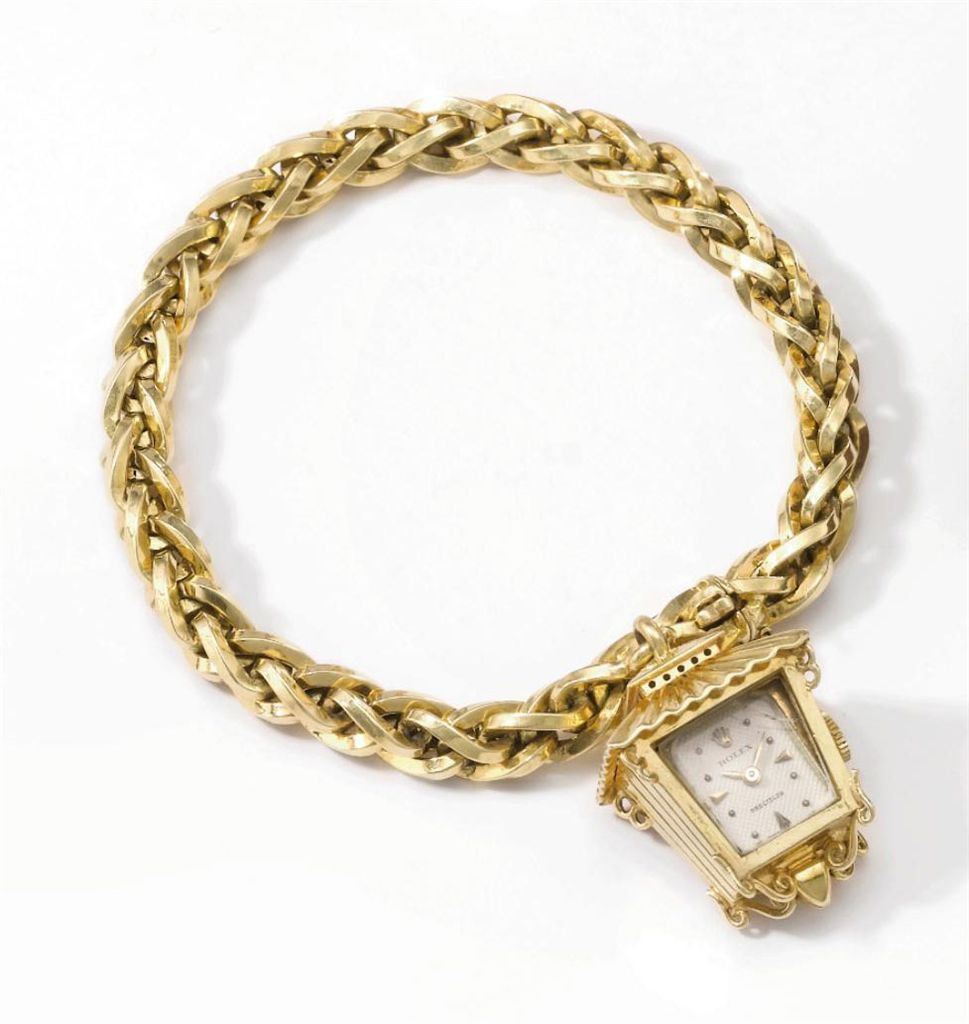 Rolex an unusual k gold lanternform bracelet watch signed rolex
