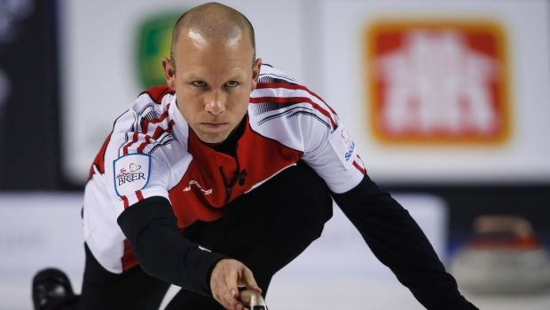 Team Canada skip Pat Simmons delivers a rock as he plays Northern Ontario during gold medal game curling action at the Brier in Calgary on Sunday.