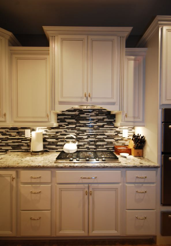 Cardell white with silver glaze and Cambria Praa Sands coutertops ...