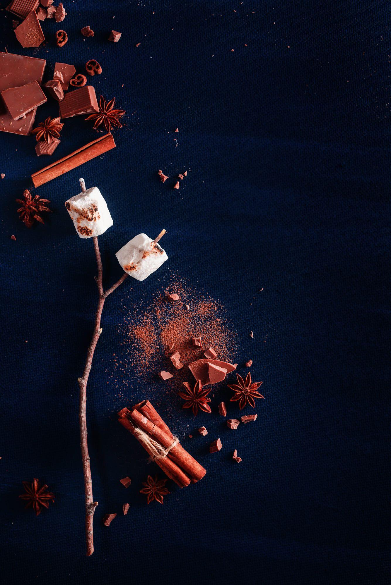 Dark food still life with roasted marshmallows, cocoa powder ...