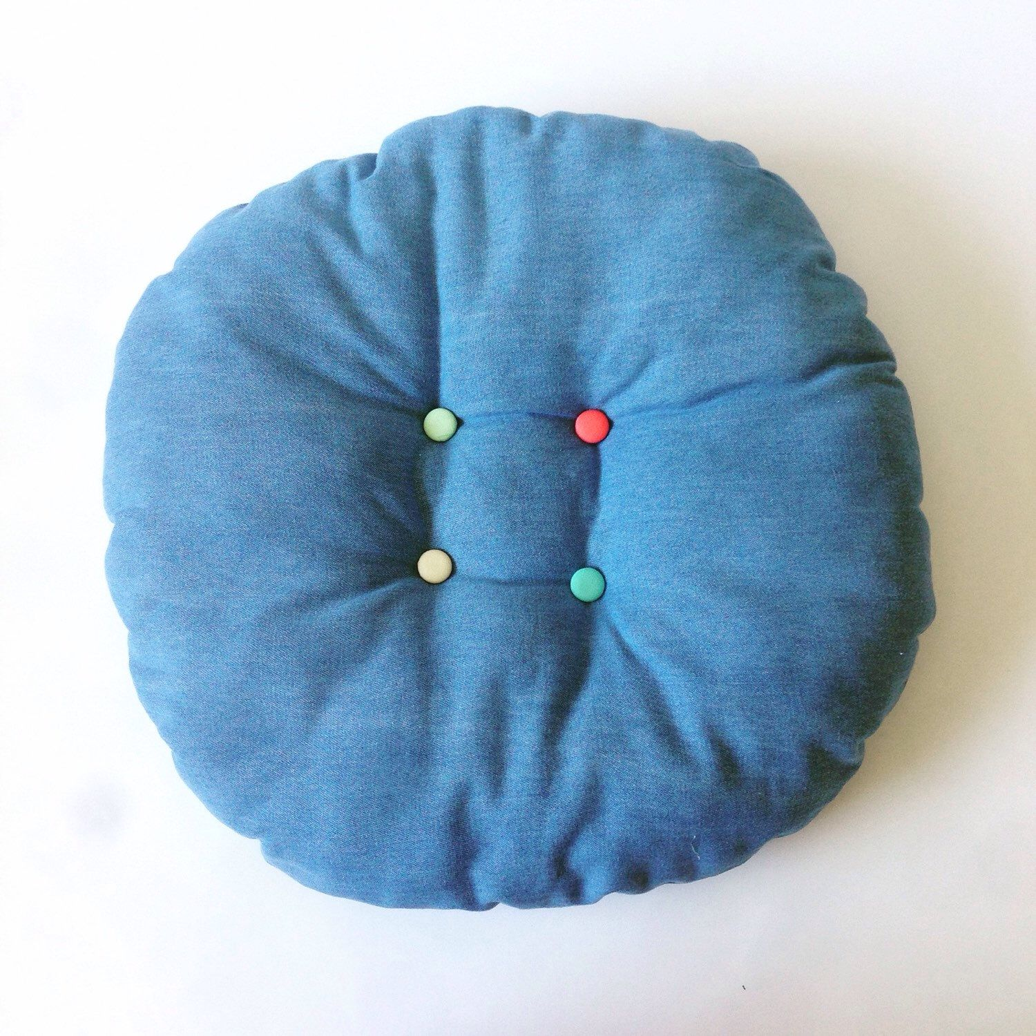 A personal favourite from my Etsy shop https://www.etsy.com/au/listing/267323955/round-denim-decorative-cushion-with